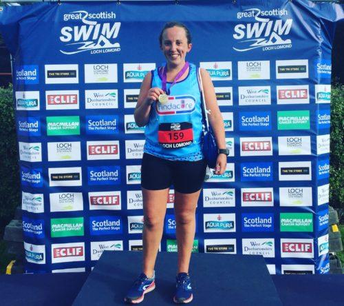 Charlotte with great Scottish swim medal