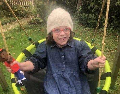 dottie on a swing in the garden