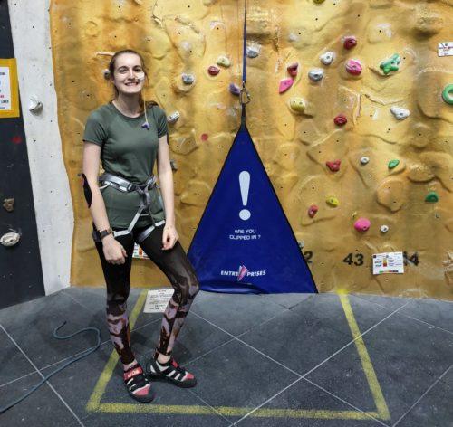 Mary ready to climb an indoor climbing wall